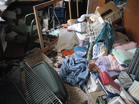 Hoarding Connection-household items and clothing on the floor.